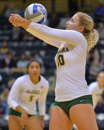 ANCHORAGE, AK - SEPTEMBER 7:  Madison Fisher #10 of the UAA Seawolves bump sets a ball in a match between the Alaska Anchorage Seawolves and the Chico State Wildcats at the Alaska Airlines Center in Anchorage, Alaska. The Seawolves won 3-1.  (Photo by Sam Wasson)