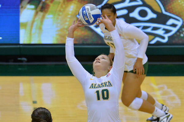 ANCHORAGE, AK - SEPTEMBER 7:  Madison Fisher #10 of the UAA Seawolves sets a ball in a match between the Alaska Anchorage Seawolves and the Chico State Wildcats at the Alaska Airlines Center in Anchorage, Alaska.  The Seawolves won 3-1.  (Photo by Sam Wasson)