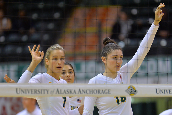 ANCHORAGE, AK - SEPTEMBER 7:  Leah Swiss #7 and Vanessa Hayes #18 of the UAA Seawolves set the defense in a match between the Alaska Anchorage Seawolves and the Chico State Wildcats at the Alaska Airlines Center in Anchorage, Alaska.  The Seawolves won 3-1.  (Photo by Sam Wasson)