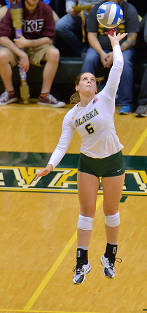 ANCHORAGE, AK - SEPTEMBER 7:  Casey Davenport #6 of the UAA Seawolves serves a ball in a match between the Alaska Anchorage Seawolves and the Chico State Wildcats at the Alaska Airlines Center in Anchorage, Alaska. The Seawolves won 3-1.  (Photo by Sam Wasson)