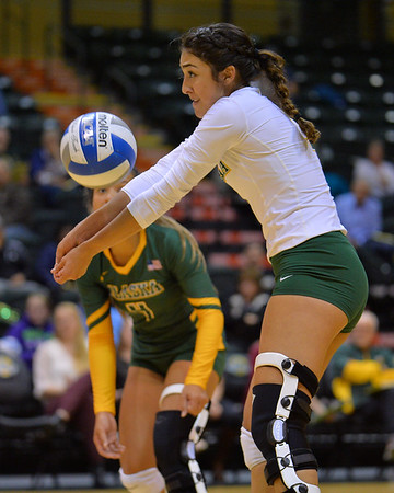 ANCHORAGE, AK - SEPTEMBER 7:  Anais Vargas #3 of the UAA Seawolves digs a ball in a match between the Alaska Anchorage Seawolves and the Chico State Wildcats at the Alaska Airlines Center in Anchorage, Alaska. The Seawolves won 3-1.  (Photo by Sam Wasson)
