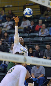 ANCHORAGE, AK - SEPTEMBER 7:  Chrisalyn Johnson #9 of the UAA Seawolves takes a swing in a match between the Alaska Anchorage Seawolves and the Chico State Wildcats at the Alaska Airlines Center in Anchorage, Alaska. The Seawolves won 3-1.  (Photo by Sam Wasson)