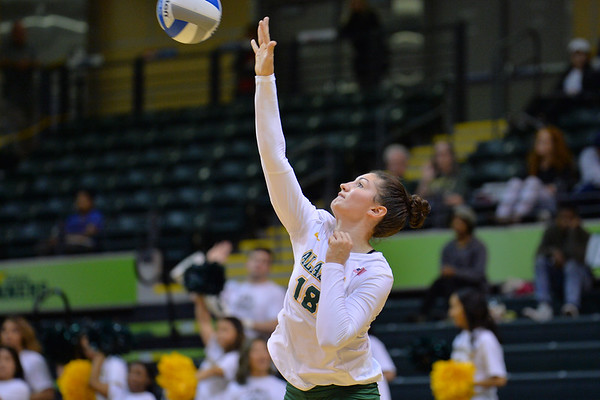 ANCHORAGE, AK - SEPTEMBER 7:  Vanessa Hayes #18 of the UAA Seawolves serves a ball in a match between the Alaska Anchorage Seawolves and the Chico State Wildcats at the Alaska Airlines Center in Anchorage, Alaska.  The Seawolves won 3-1.  (Photo by Sam Wasson)