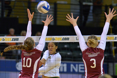ANCHORAGE, AK - SEPTEMBER 7:  Diana Fa'amausili #17 of the UAA Seawolves hits a ball past the block of Bekah Boyle (L) #10 and Kim Wright #3 of the Chico State Wildcats in a match between the Alaska Anchorage Seawolves and the Chico State Wildcats at the Alaska Airlines Center in Anchorage, Alaska. The Seawolves won 3-1.  (Photo by Sam Wasson)