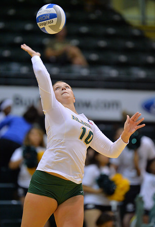 ANCHORAGE, AK - SEPTEMBER 7:  Madison Fisher #10 of the UAA Seawolves serves a ball in a match between the Alaska Anchorage Seawolves and the Chico State Wildcats at the Alaska Airlines Center in Anchorage, Alaska. The Seawolves won 3-1.  (Photo by Sam Wasson)