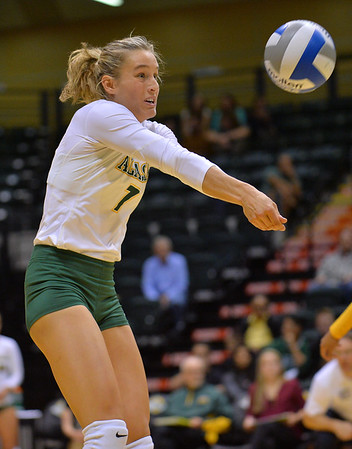ANCHORAGE, AK - SEPTEMBER 7:  Leah Swiss #7 of the UAA Seawolves digs a ball in a match between the Alaska Anchorage Seawolves and the Chico State Wildcats at the Alaska Airlines Center in Anchorage, Alaska. The Seawolves won 3-1.  (Photo by Sam Wasson)