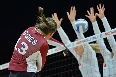 September 18, 2015: Nathalie Castellanos tries to split the Arizona block in a match between New Mexico State and No. 16 Arizona at McKale Memorial Center in Tucson, Ariz.