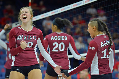 September 18, 2015: Ashlyn Brown and Nathalie Castellanos celebrate a point in a match between New Mexico State and No. 16 Arizona at McKale Memorial Center in Tucson, Ariz.