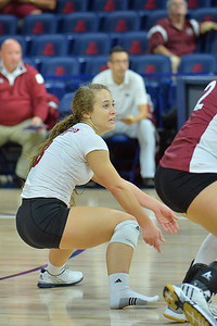 September 18, 2015: Kaylee Neal plays defense without one her shoes in a match between New Mexico State and No. 16 Arizona at McKale Memorial Center in Tucson, Ariz.
