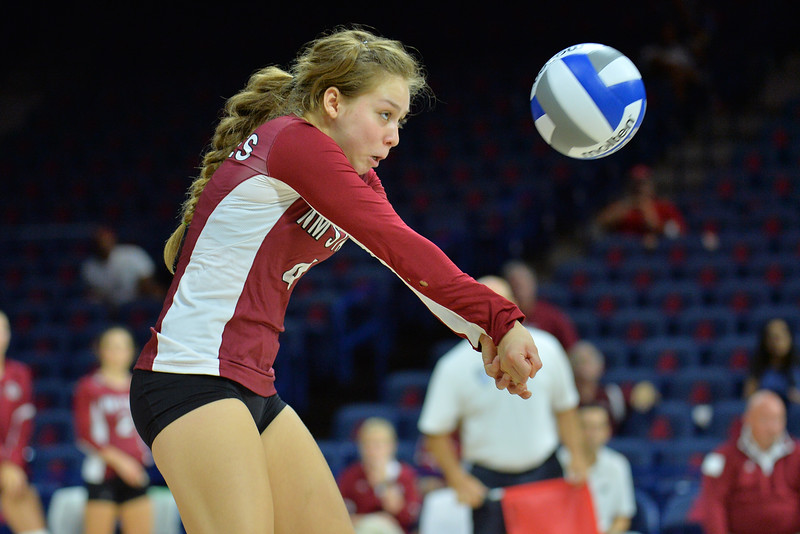 September 18, 2015: Ariadnne Sierra digs a ball in a match between New Mexico State and No. 16 Arizona at McKale Memorial Center in Tucson, Ariz.