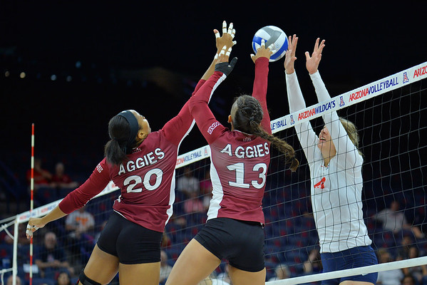 September 18, 2015: Sasha-Lee Thomas and Nathalie Castellanos try to send a ball over in a match between New Mexico State and No. 16 Arizona at McKale Memorial Center in Tucson, Ariz.