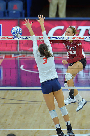 September 18, 2015: Gwen Murphy fires a ball past the Arizona blocker in a match between New Mexico State and No. 16 Arizona at McKale Memorial Center in Tucson, Ariz.