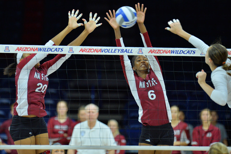 September 19, 2015: Sasha-Lee Thomas and Tatyana Battle block a Texas attack in a match between New Mexico State and No. 2 Texas at McKale Memorial Center in Tucson, Ariz.