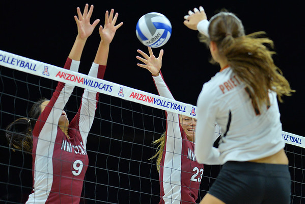 September 19, 2015: Bradley Nash and Gwen Murphy block an attack from Texas outside hitter Paulina Prieto Cerame (19) in a match between New Mexico State and No. 2 Texas at McKale Memorial Center in Tucson, Ariz.