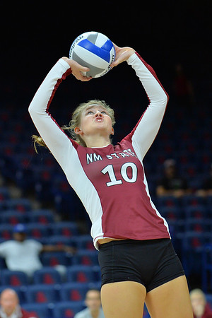 September 19, 2015: Ashlyn Brown sets a ball in a match between New Mexico State and No. 2 Texas at McKale Memorial Center in Tucson, Ariz.
