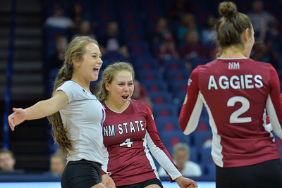 September 19, 2015: Kaylee Neal and Ariadnne Sierra celebrate a service ace by Taylor Livoti in a match between New Mexico State and No. 2 Texas at McKale Memorial Center in Tucson, Ariz.
