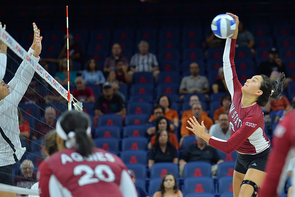 September 19, 2015: Bradley Nash takes a swing in a match between New Mexico State and No. 2 Texas at McKale Memorial Center in Tucson, Ariz.