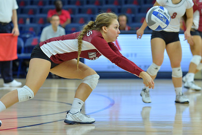 September 19, 2015: Ariadnne Sierra digs a ball in a match between New Mexico State and No. 2 Texas at McKale Memorial Center in Tucson, Ariz.