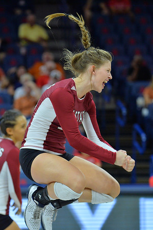 September 19, 2015: Ashlyn Brown celebrates a point in a match between New Mexico State and No. 2 Texas at McKale Memorial Center in Tucson, Ariz.