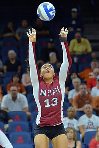 September 19, 2015: Nathalie Castellanos sets a ball in a match between New Mexico State and No. 2 Texas at McKale Memorial Center in Tucson, Ariz.