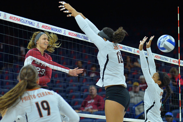 September 19, 2015: Gwen Murphy powers a ball through the Texas block in a match between New Mexico State and No. 2 Texas at McKale Memorial Center in Tucson, Ariz.