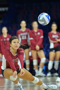 September 19, 2015: Jordan Abalos digs a ball in a match between New Mexico State and No. 2 Texas at McKale Memorial Center in Tucson, Ariz.
