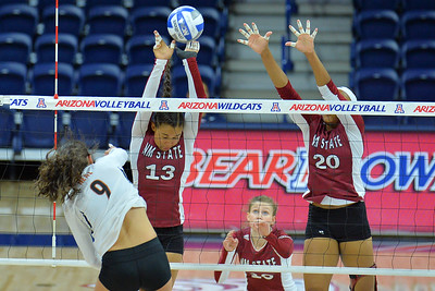 September 19, 2015: Nathalie Castellanos and Sasha-Lee Thomas team up for a block against Texas outside hitter Amy Neal (9) in a match between New Mexico State and No. 2 Texas at McKale Memorial Center in Tucson, Ariz.