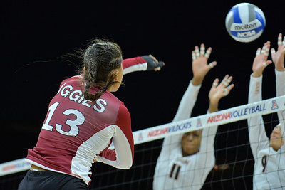 September 19, 2015: Nathalie Castellanos hits through the Texas block in a match between New Mexico State and No. 2 Texas at McKale Memorial Center in Tucson, Ariz.