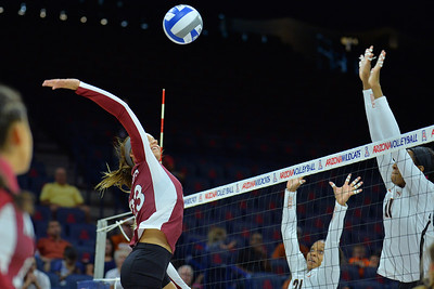 September 19, 2015: Gwen Murphy takes a swing in a match between New Mexico State and No. 2 Texas at McKale Memorial Center in Tucson, Ariz.
