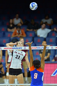 September 18, 2015: Bryn Popovich attacks a ball in a match between New Mexico State and Savannah State at McKale Memorial Center in Tucson, Ariz.