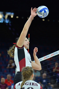 September 18, 2015: Audra Jones takes a swing in a match between New Mexico State and Savannah State at McKale Memorial Center in Tucson, Ariz.