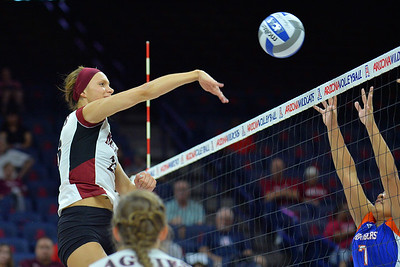 September 18, 2015: Gwen Murphy fires a ball over the Savannah State  block in a match between New Mexico State and Savannah State at McKale Memorial Center in Tucson, Ariz.