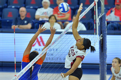 September 18, 2015: Sasha-Lee Thomas takes a swing in a match between New Mexico State and Savannah State at McKale Memorial Center in Tucson, Ariz.