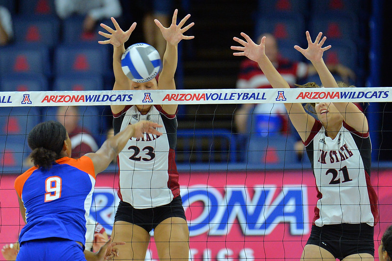 September 18, 2015: Gwen Murphy blocks a ball in a match between New Mexico State and Savannah State at McKale Memorial Center in Tucson, Ariz.