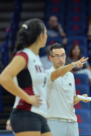 September 18, 2015: New Mexico State assistant coach Ben Wallis gives his team instruction in a match between New Mexico State and Savannah State at McKale Memorial Center in Tucson, Ariz.