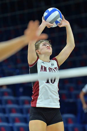 September 18, 2015: Ashlyn Brown sets a ball in a match between New Mexico State and Savannah State at McKale Memorial Center in Tucson, Ariz.