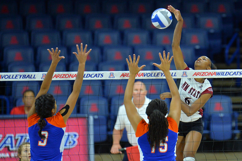September 18, 2015: Tatyana Battle attacks a ball in a match between New Mexico State and Savannah State at McKale Memorial Center in Tucson, Ariz.