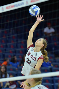 September 18, 2015: Bryn Popovich takes a swing in a match between New Mexico State and Savannah State at McKale Memorial Center in Tucson, Ariz.