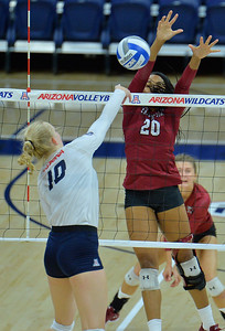 TUCSON, AZ - SEPTEMBER 15:  Sasha-Lee Thomas #20 of the New Mexico State Aggies goes up for a block against Paige Whipple #10 of the Arizona Wildcats in a match between the New Mexico State Aggies and the Arizona Wildcats at the McKale Center in Tucson, Arizona. The Wildcats won 3-2.  (Photo by Sam Wasson)
