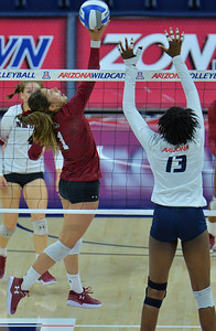 TUCSON, AZ - SEPTEMBER 15:  Briana Ainsworth #1 of the New Mexico State Aggies makes a one-handed set in a match between the New Mexico State Aggies and the Arizona Wildcats at the McKale Center in Tucson, Arizona. The Wildcats won 3-2.  (Photo by Sam Wasson)
