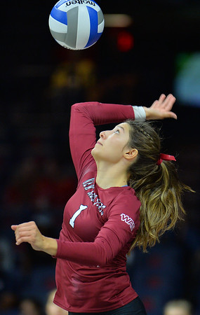 TUCSON, AZ - SEPTEMBER 15:  Briana Ainsworth #1 of the New Mexico State Aggies serves a ball in a match between the New Mexico State Aggies and the Arizona Wildcats at the McKale Center in Tucson, Arizona. The Wildcats won 3-2.  (Photo by Sam Wasson)