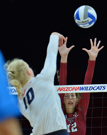TUCSON, AZ - SEPTEMBER 15:  Megan Hart #12 of the New Mexico State Aggies goes up for a block attempt against Paige Whipple #10 of the Arizona Wildcats in a match between the New Mexico State Aggies and the Arizona Wildcats at the McKale Center in Tucson, Arizona. The Wildcats won 3-2.  (Photo by Sam Wasson)