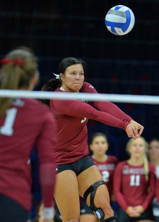 TUCSON, AZ - SEPTEMBER 15:  Jordan Abalos #3 of the New Mexico State Aggies digs a ball in a match between the New Mexico State Aggies and the Arizona Wildcats at the McKale Center in Tucson, Arizona. The Wildcats won 3-2.  (Photo by Sam Wasson)