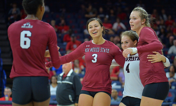TUCSON, AZ - SEPTEMBER 15:  The New Mexico State Aggies celebrate after winning a point in a match between the New Mexico State Aggies and the Arizona Wildcats at the McKale Center in Tucson, Arizona. The Wildcats won 3-2.  (Photo by Sam Wasson)