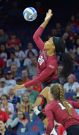 TUCSON, AZ - SEPTEMBER 15:  Sasha-Lee Thomas #20 of the New Mexico State Aggies takes a swing in a match between the New Mexico State Aggies and the Arizona Wildcats at the McKale Center in Tucson, Arizona. The Wildcats won 3-2.  (Photo by Sam Wasson)