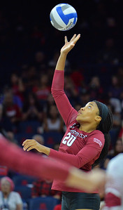 TUCSON, AZ - SEPTEMBER 15:  Sasha-Lee Thomas #20 of the New Mexico State Aggies tips a ball in a match between the New Mexico State Aggies and the Arizona Wildcats at the McKale Center in Tucson, Arizona. The Wildcats won 3-2.  (Photo by Sam Wasson)
