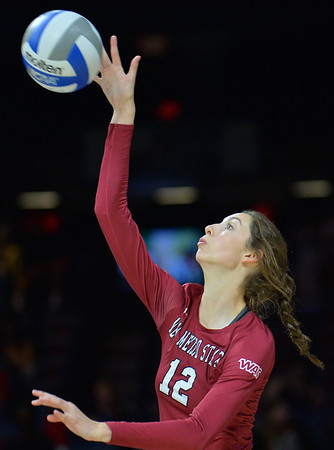 TUCSON, AZ - SEPTEMBER 15:  Megan Hart #12 of the New Mexico State Aggies serves a ball in a match between the New Mexico State Aggies and the Arizona Wildcats at the McKale Center in Tucson, Arizona. The Wildcats won 3-2.  (Photo by Sam Wasson)