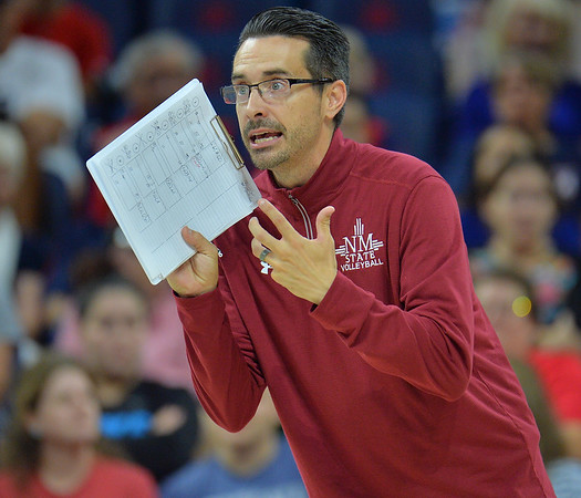 TUCSON, AZ - SEPTEMBER 15:  Associate head coach Ben Wallis of the New Mexico State Aggies shouts instructions to his team in a match between the New Mexico State Aggies and the Arizona Wildcats at the McKale Center in Tucson, Arizona. The Wildcats won 3-2.  (Photo by Sam Wasson)