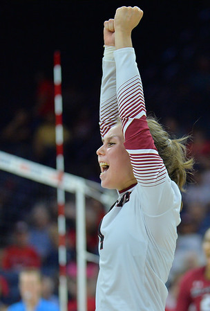 TUCSON, AZ - SEPTEMBER 15:  Ariadnne Sierra #4 of the New Mexico State Aggies celebrates after her team wins a point in a match between the New Mexico State Aggies and the Arizona Wildcats at the McKale Center in Tucson, Arizona. The Wildcats won 3-2.  (Photo by Sam Wasson)