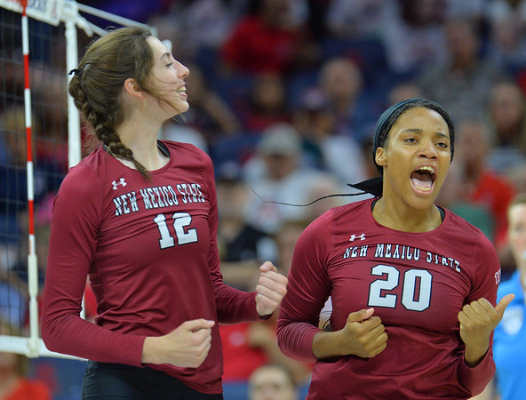 TUCSON, AZ - SEPTEMBER 15:  Megan Hart #12 and Sasha-Lee Thomas #20 of the New Mexico State Aggies celebrate after their team wins a point in a match between the New Mexico State Aggies and the Arizona Wildcats at the McKale Center in Tucson, Arizona. The Wildcats won 3-2.  (Photo by Sam Wasson)